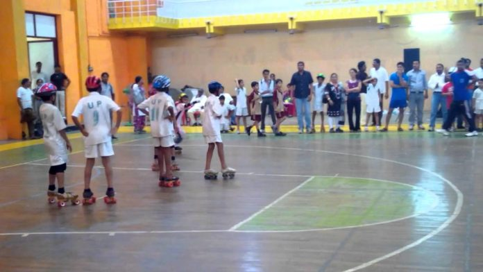 A game of roll ball between two opposing teams on the court. Asian Roll Ball Championship
