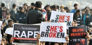 Young girls gathered oustide Rashtrapati Bhavan with placards.