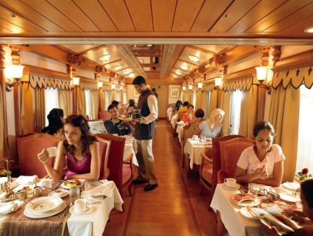 Attendants serving Guests inside Palace on Wheels.