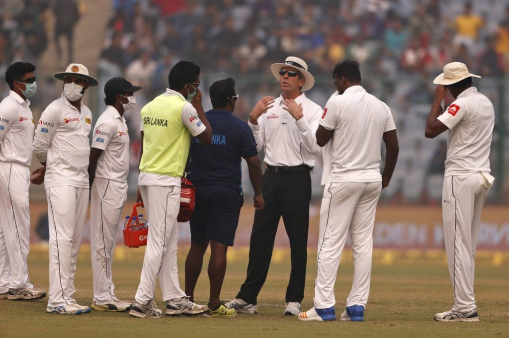 Sri Lankan Players discussing pollution issue with Umpire